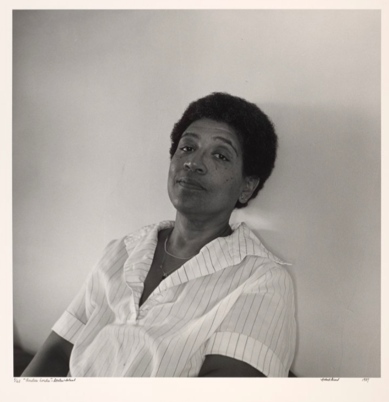 This image is a black and white photograph of activist Audre Lorde.